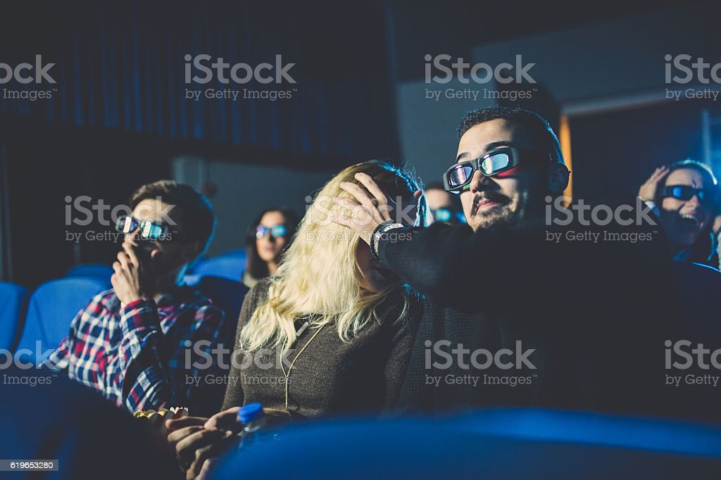 Friends watching a horror stock photo