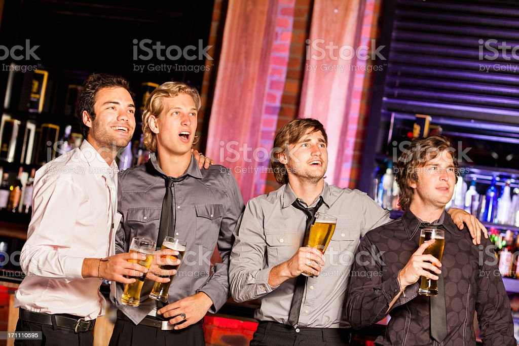 Friends Watching A Sportsgame stock photo