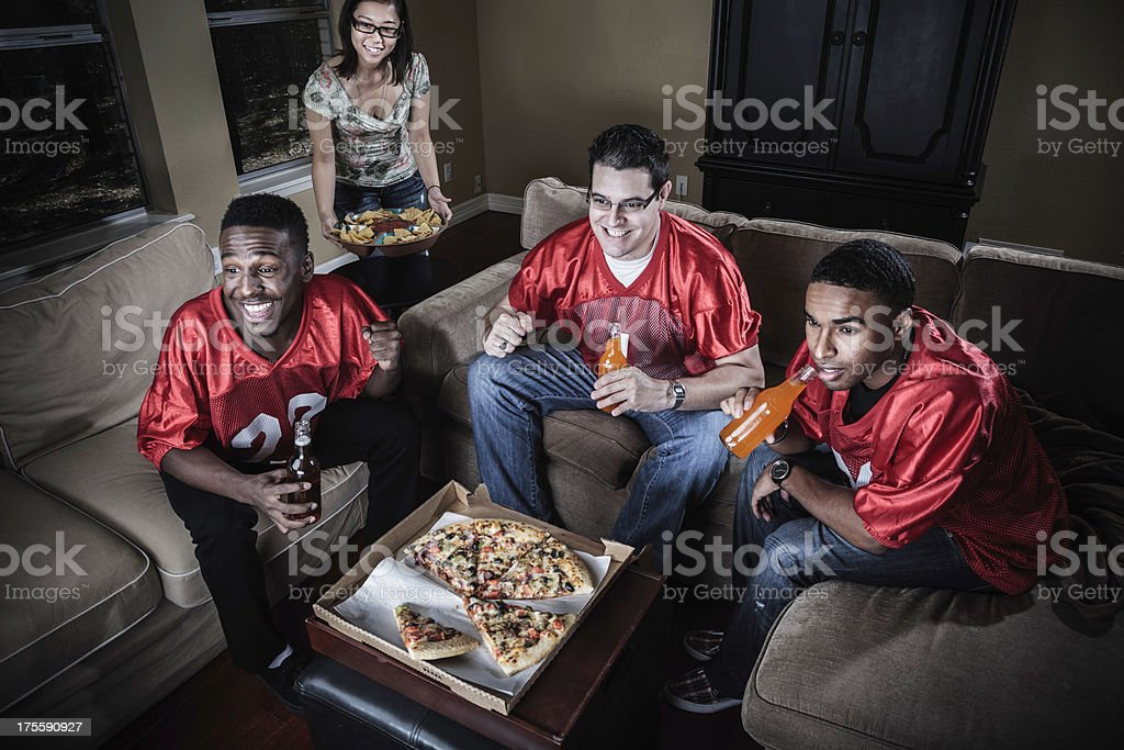 friends watching football on TV stock photo