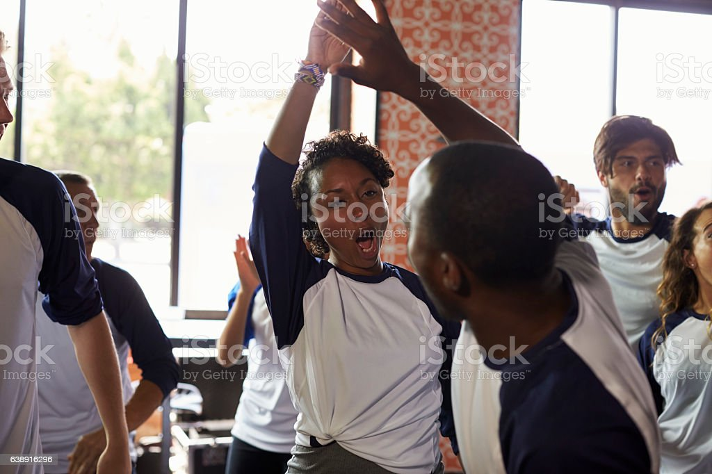 Friends Watching Game In Sports Bar Celebrating stock photo