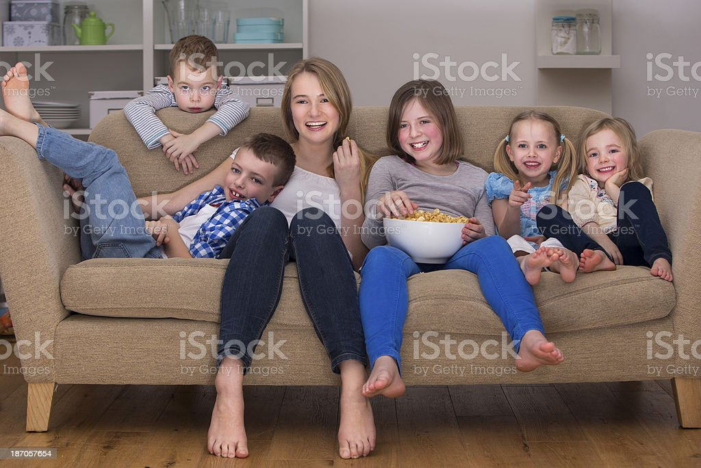 Friends watching television royalty-free stock photo