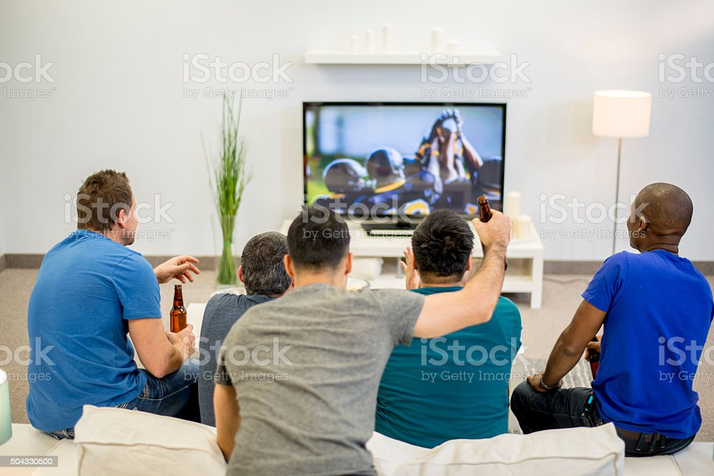 Friends Watching the Game Together stock photo