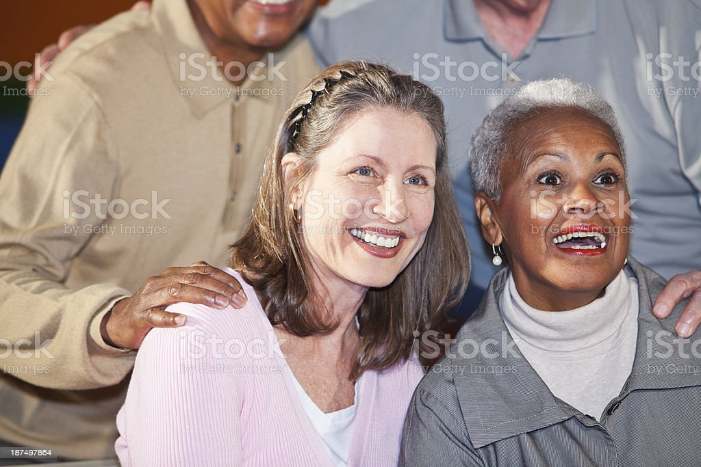 Friends watching together stock photo