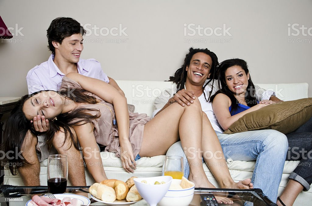 Friends watching tv royalty-free stock photo