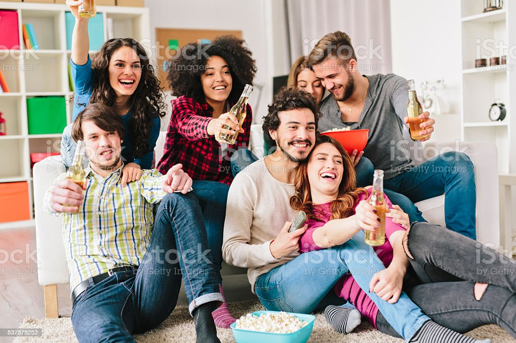 Friends watching TV stock photo