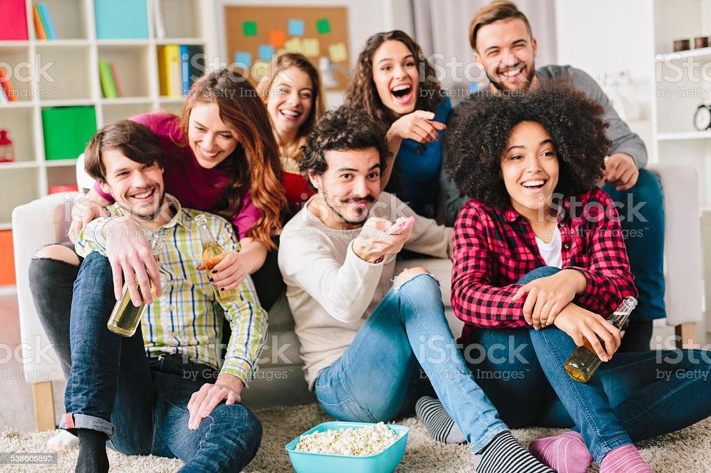 Friends watching TV stock photo