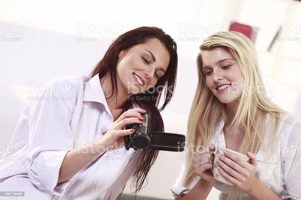 Friends watching video on camera royalty-free stock photo