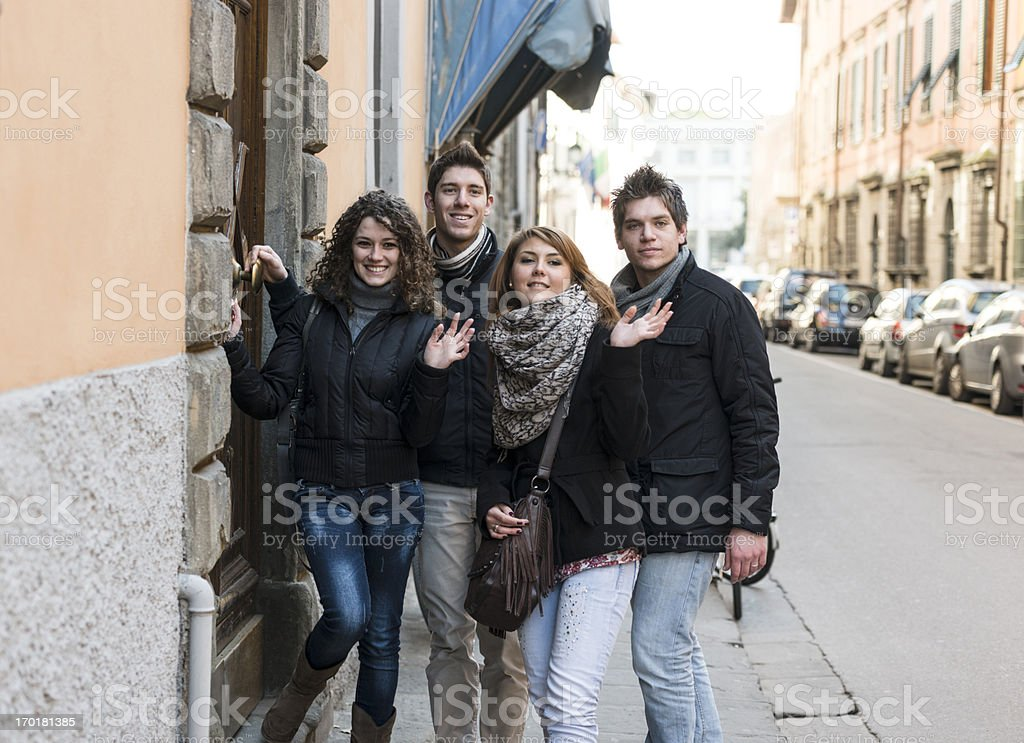 Friends waving hands at the house door royalty-free stock photo