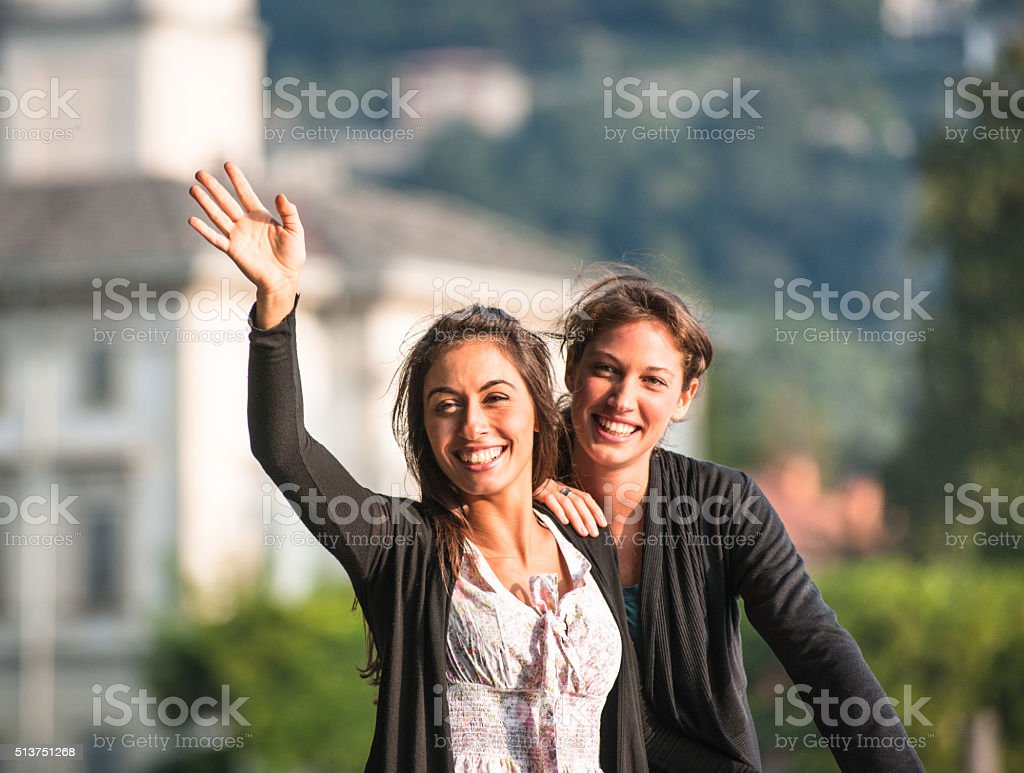 friends waving hands on the summer vacations stock photo