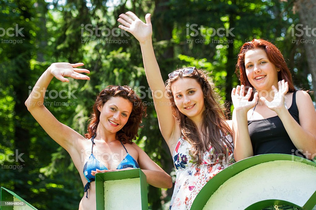 Friends waving royalty-free stock photo
