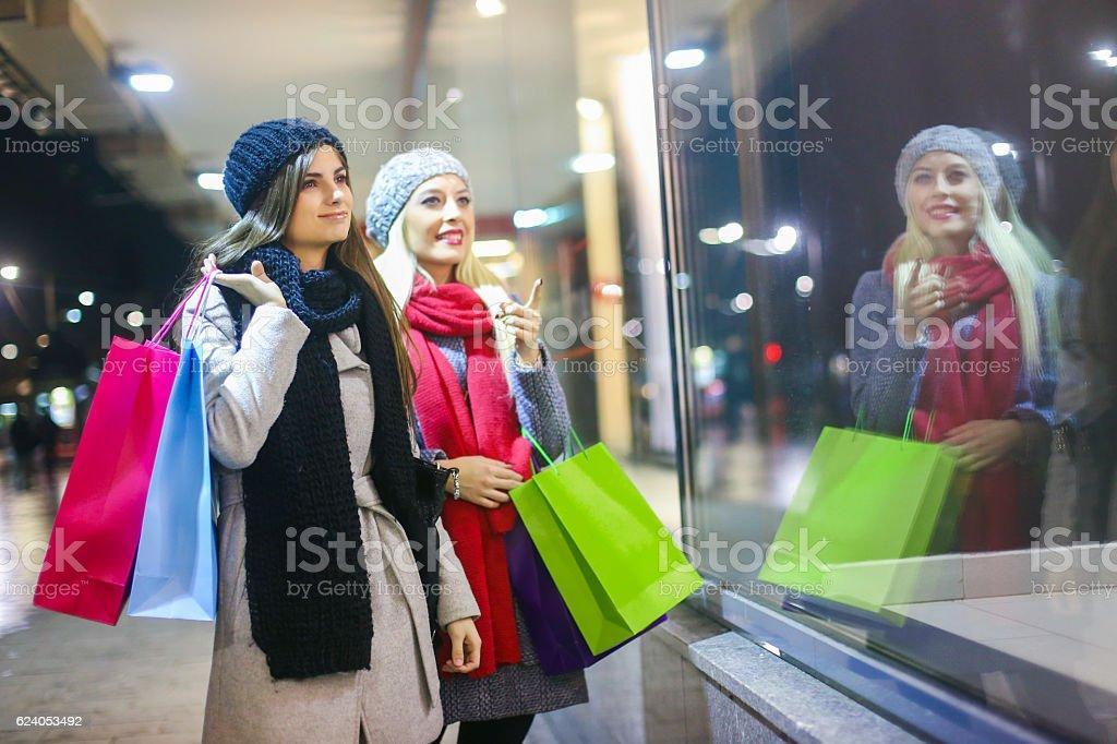 Friends window shopping stock photo
