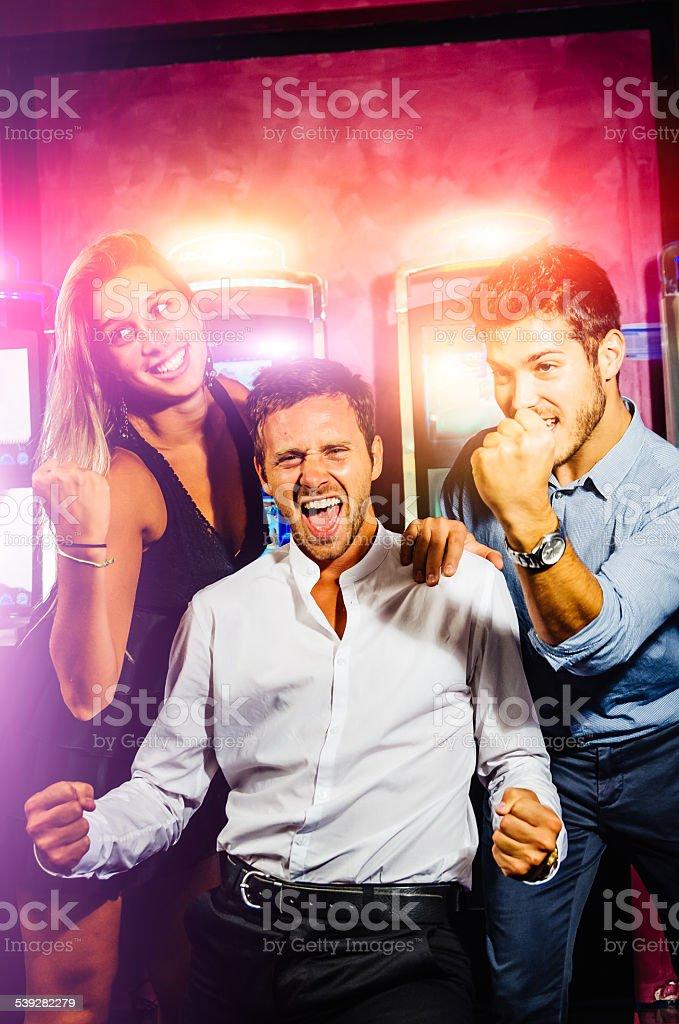 Friends Winning At Casino stock photo