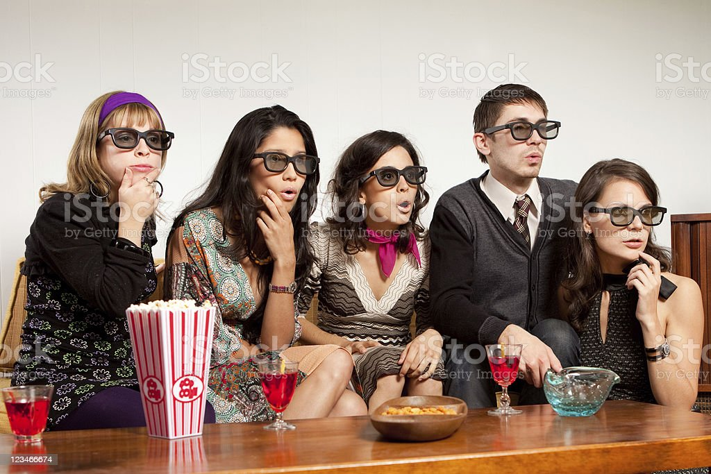 Friends with 3D glasses watching TV stock photo