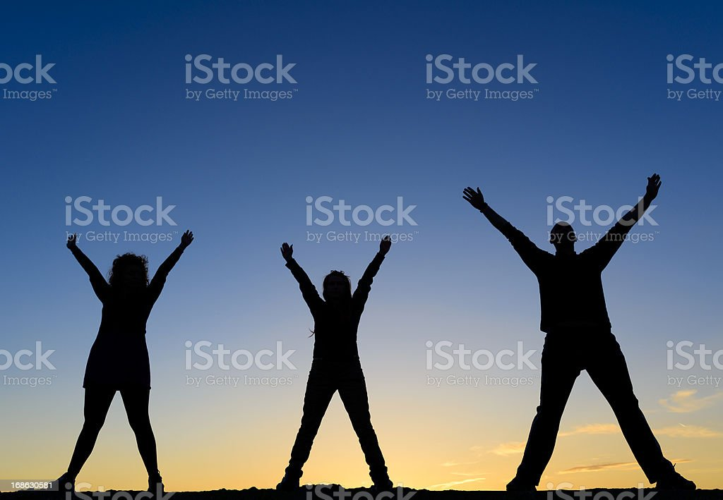 friends with arms raised royalty-free stock photo