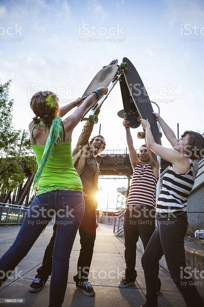 Friends with Skateboards High Five royalty-free stock photo