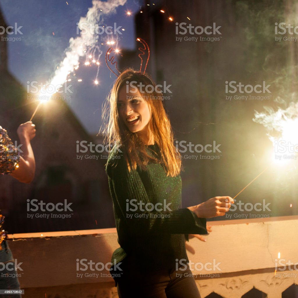 Friends with sparklers stock photo