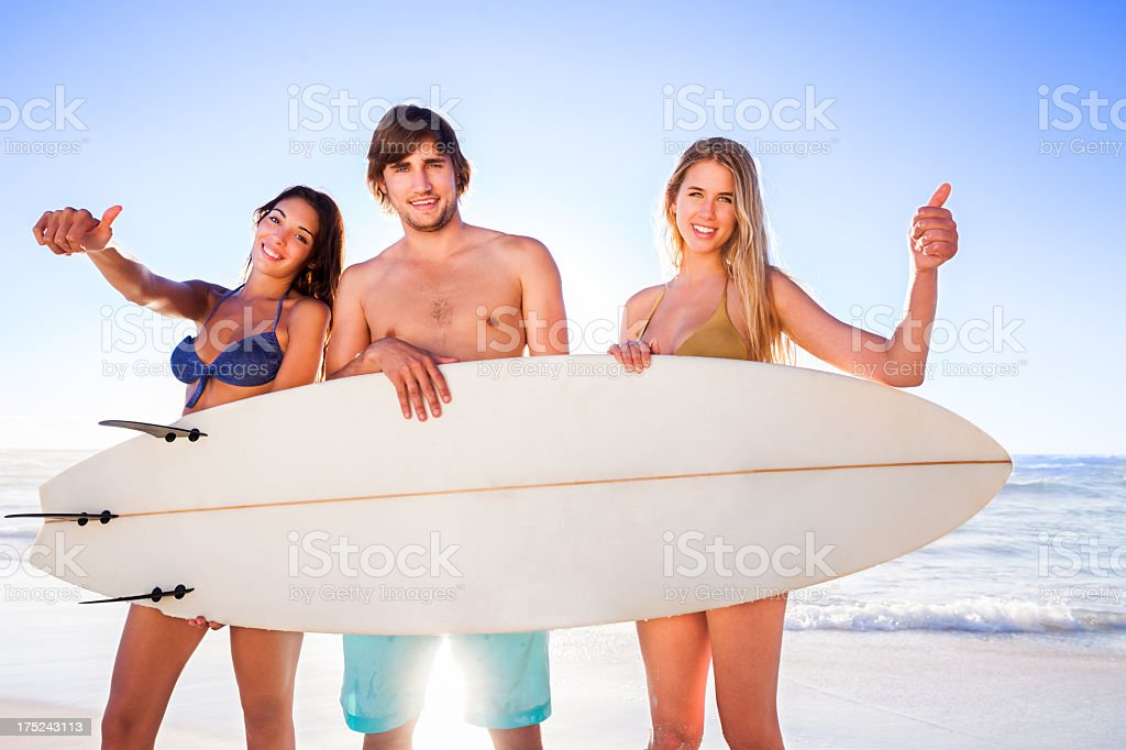 Friends With Surf Board on the beach stock photo