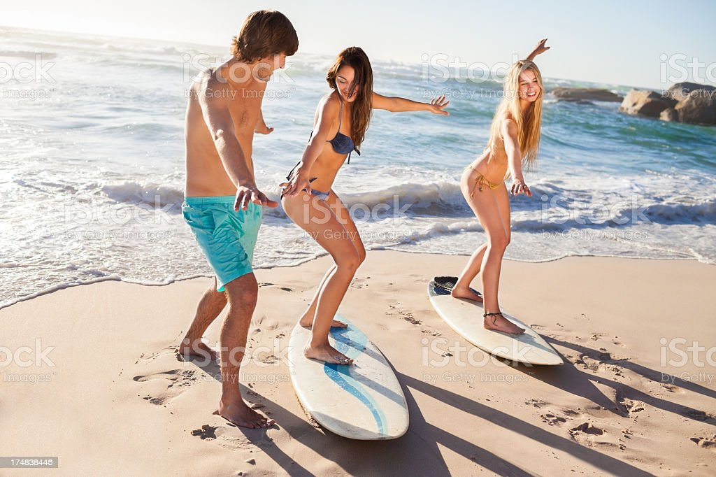 Friends With Surf Boards on the beach stock photo