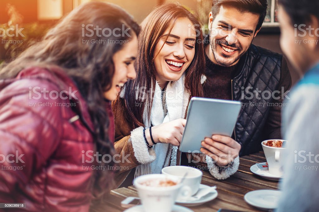Friends with tablet stock photo