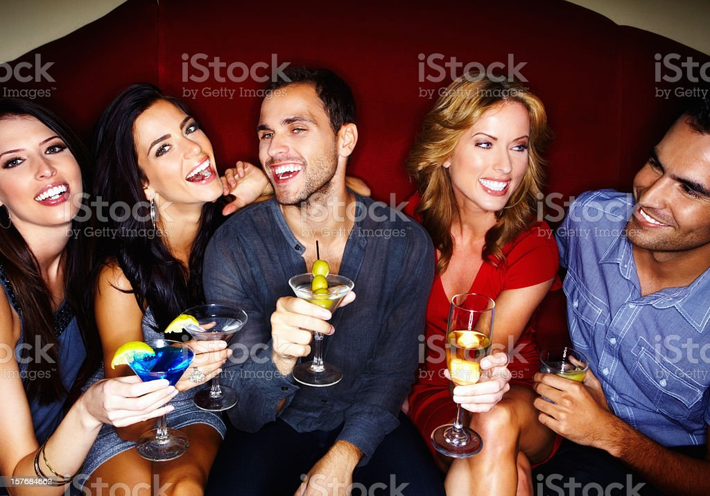 Friends with their drinks having fun at a nightclub royalty-free stock photo