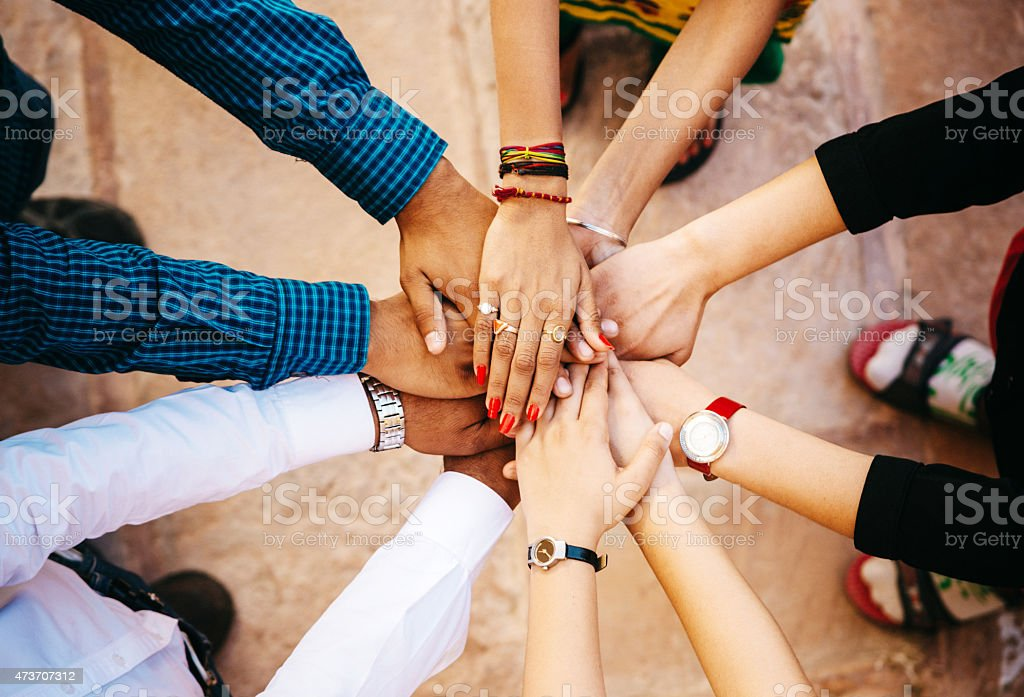 Friends With Their Hands Together stock photo