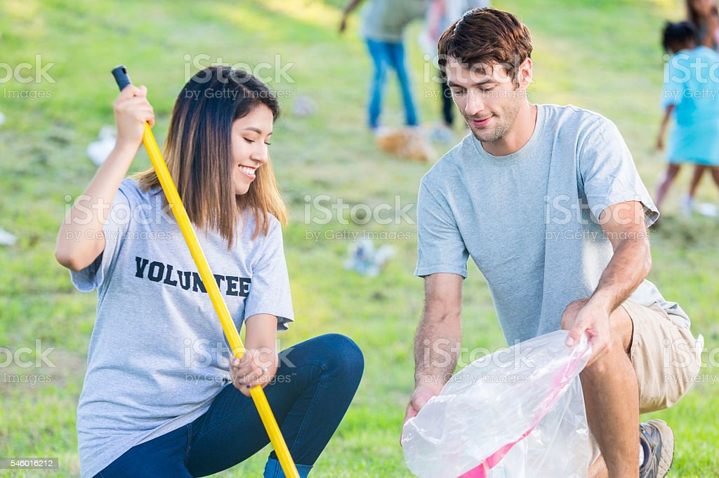 Friends work togther to beautify  park stock photo
