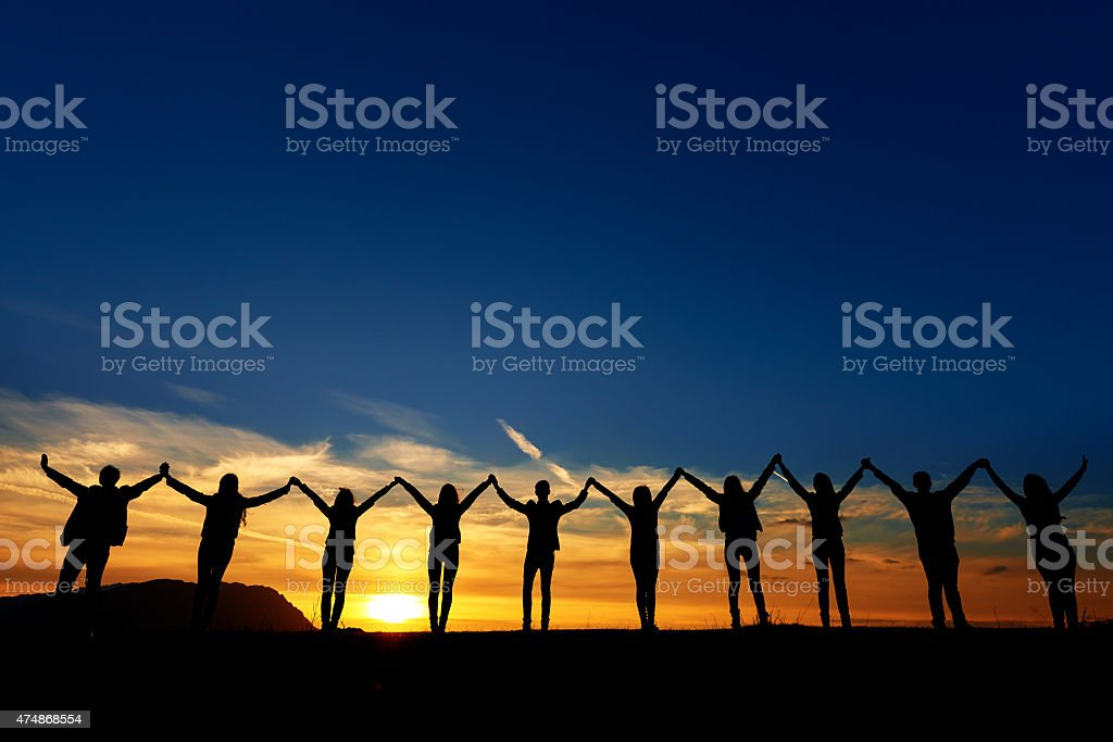 friendship and unity at sunset stock photo