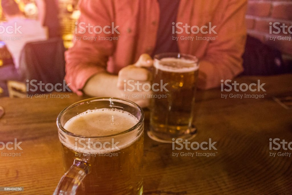 friendship concept - friends drinking beer stock photo