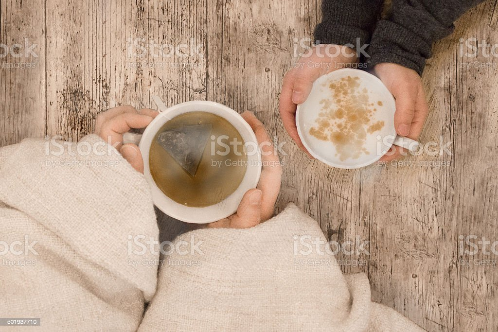 Friendship concept with two friends talking over coffee and tea. stock photo