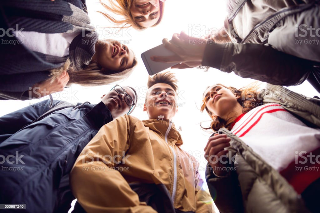 Friendship, group of teenagers hanging out stock photo