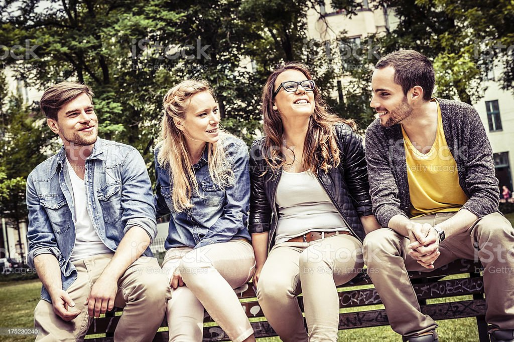 Friendship on a Bench, Young Adults at the Park royalty-free stock photo