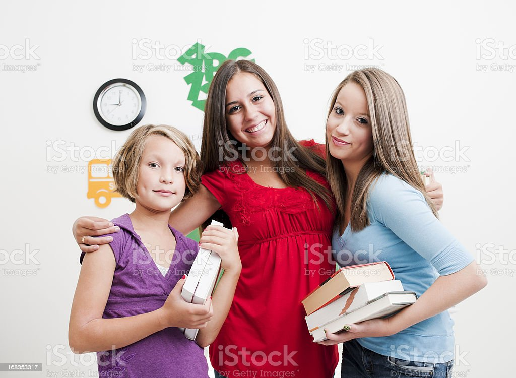 Friendship, Teenagers in Classroom Setting royalty-free stock photo