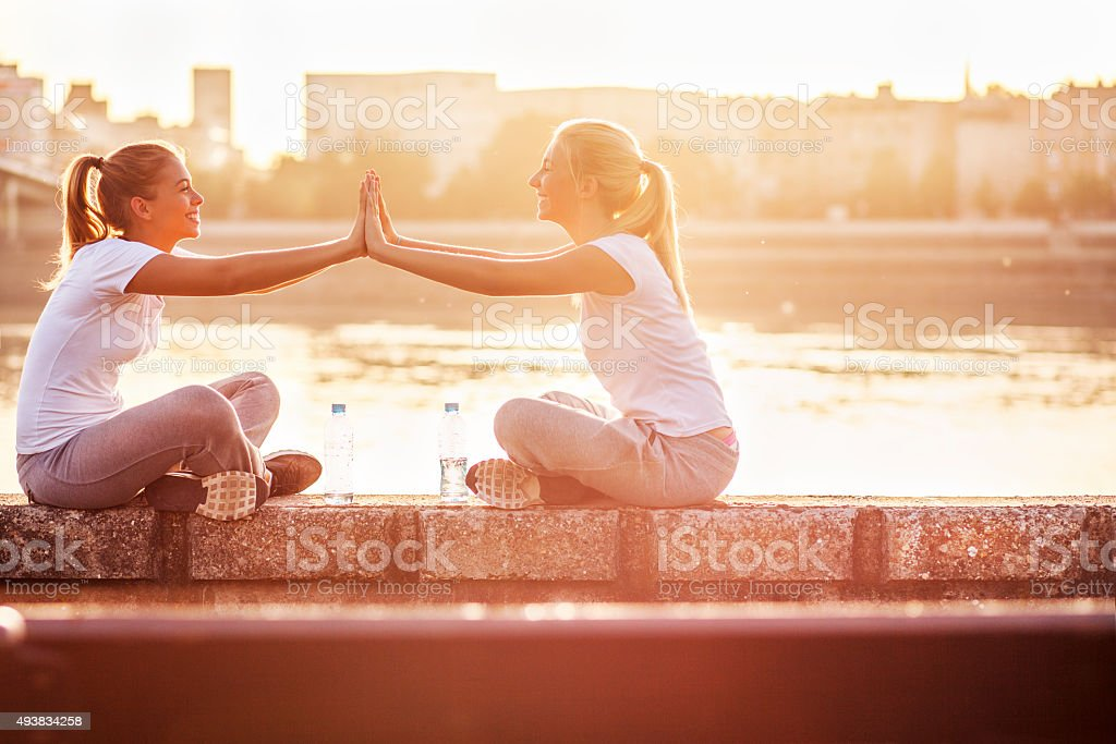 Friendship, two girls having fun together stock photo