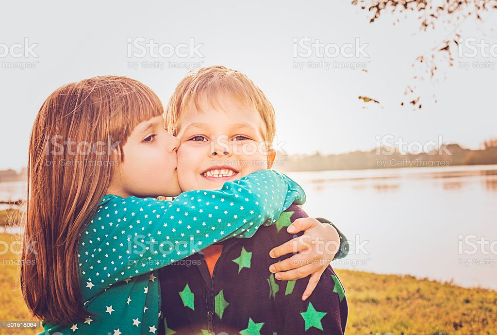 Friendship - who children hugging and kissing stock photo