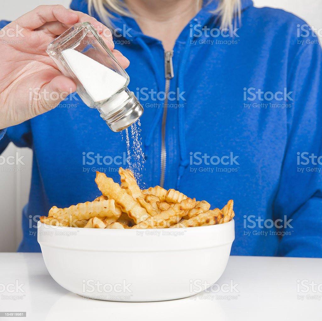 Fries and salt stock photo