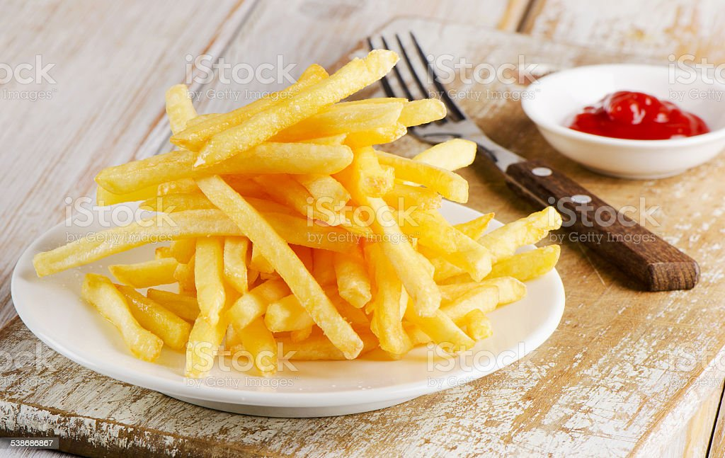 fries on a  wooden board stock photo