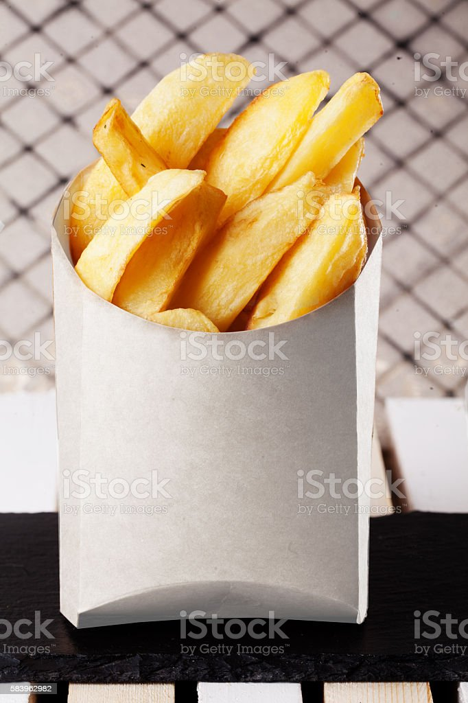 fries slices in a box fast food potatoes stock photo