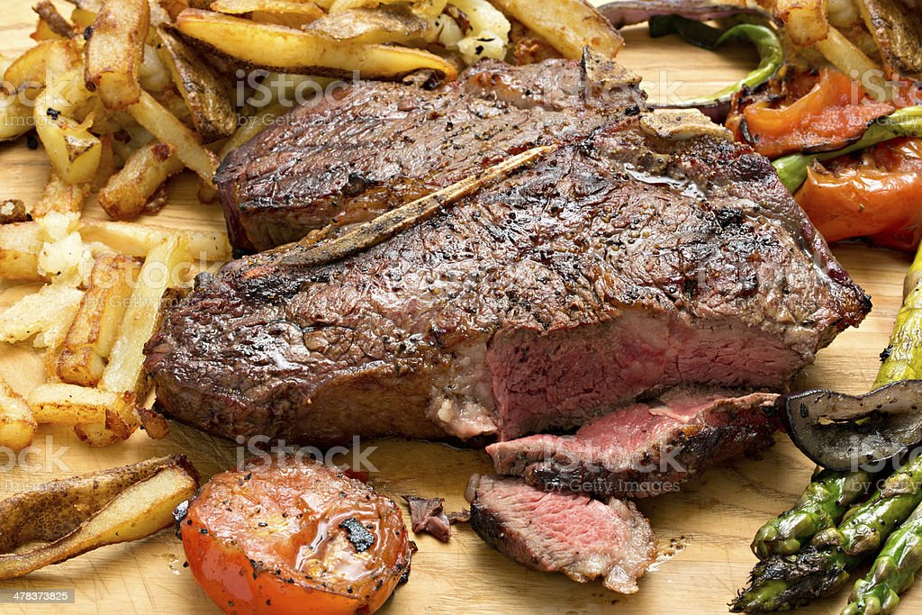 Fries, Vegetables And A Steak stock photo