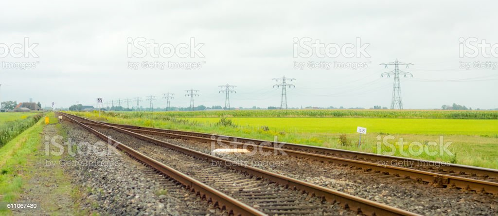 Friesland dutch northern province with empty railroad track pylons stock photo