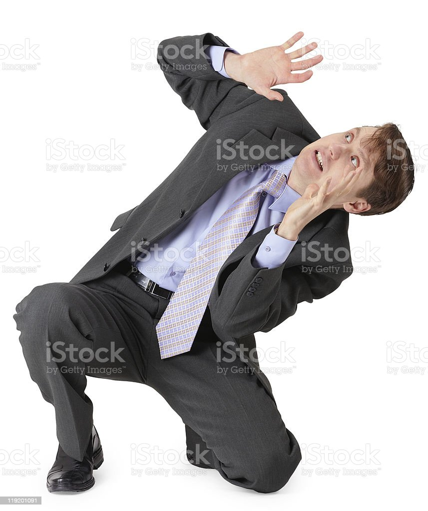 Frightened businessman sitting on white background royalty-free stock photo