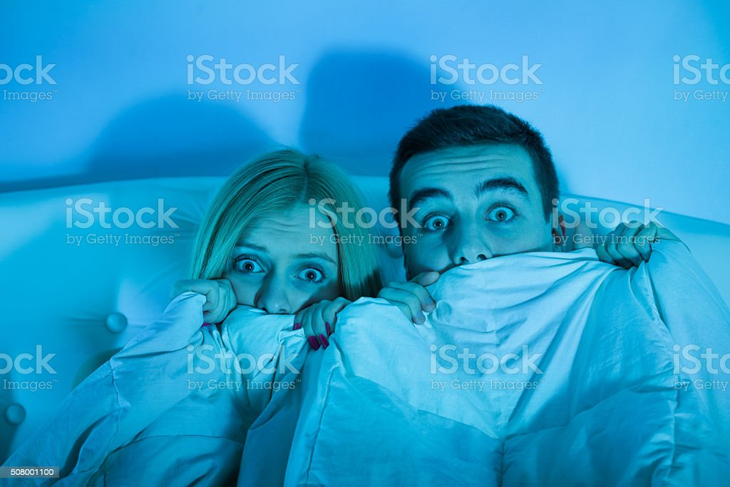 frightened couple at home stock photo