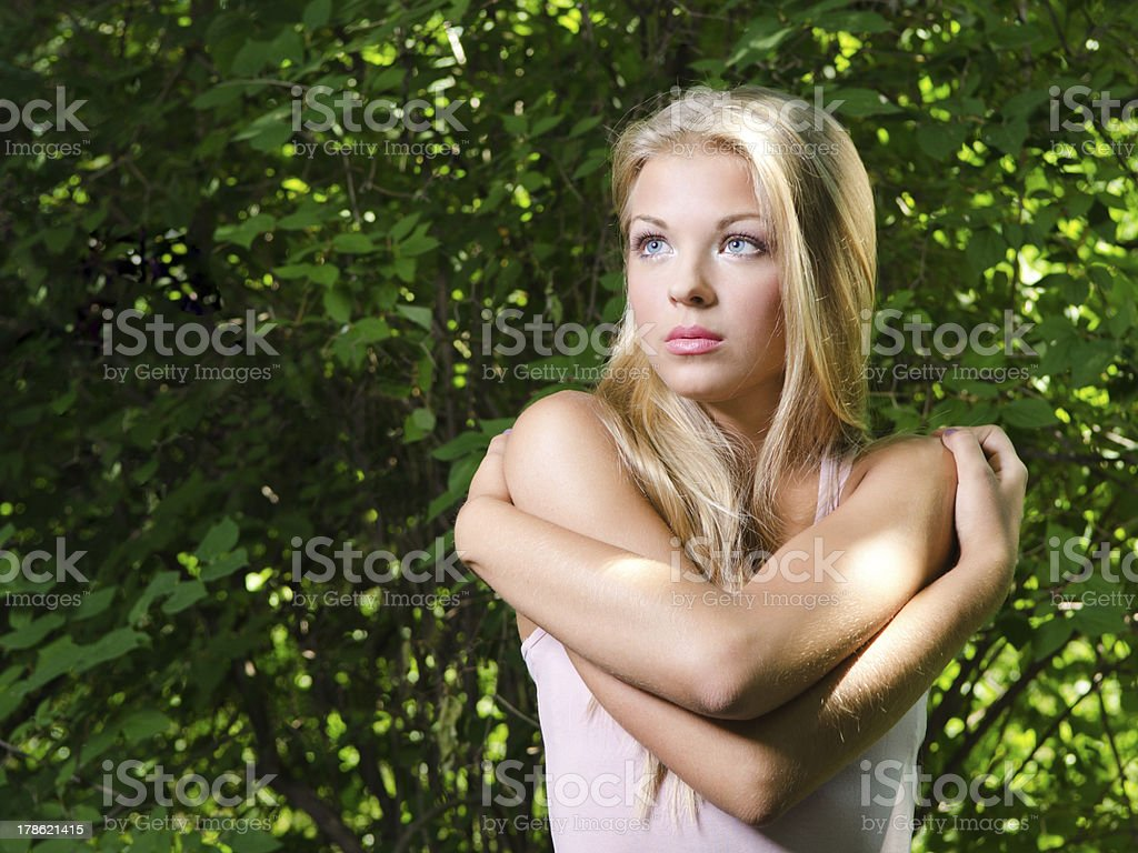 Frightened girl at the garden stock photo