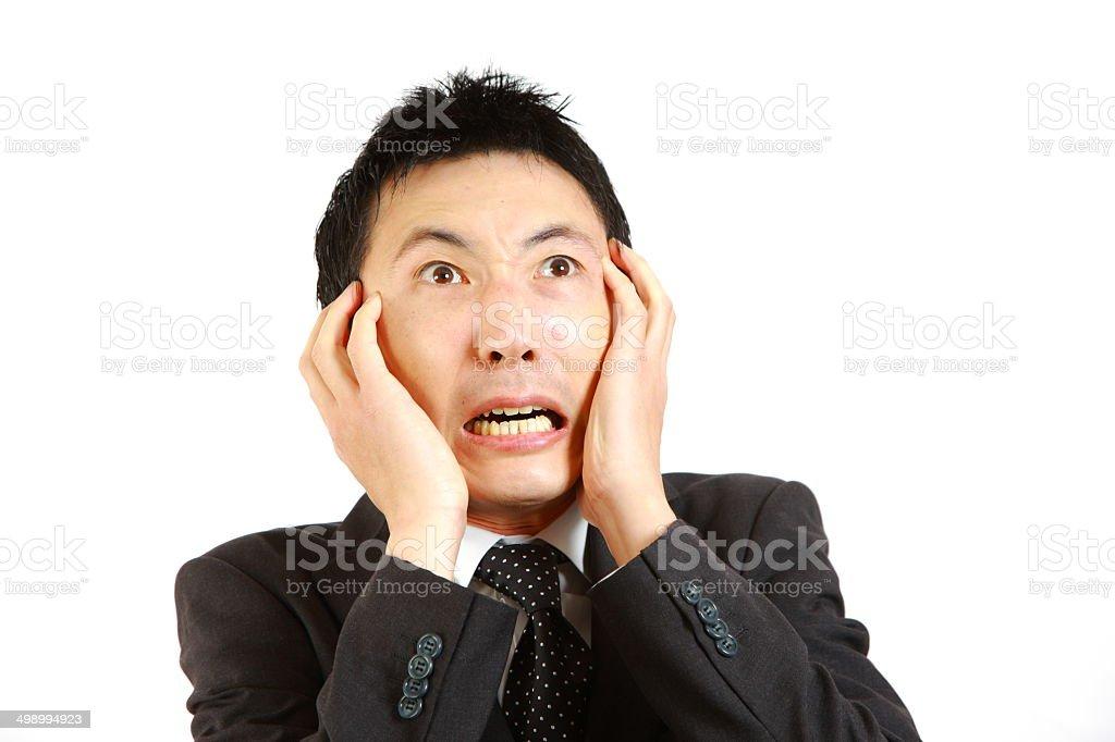 Frightened Japanese businessman stock photo