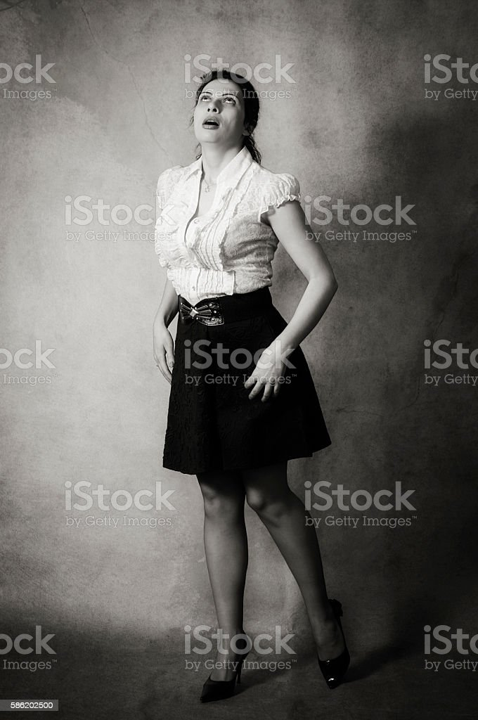 Frightened Jewish woman looking up stock photo