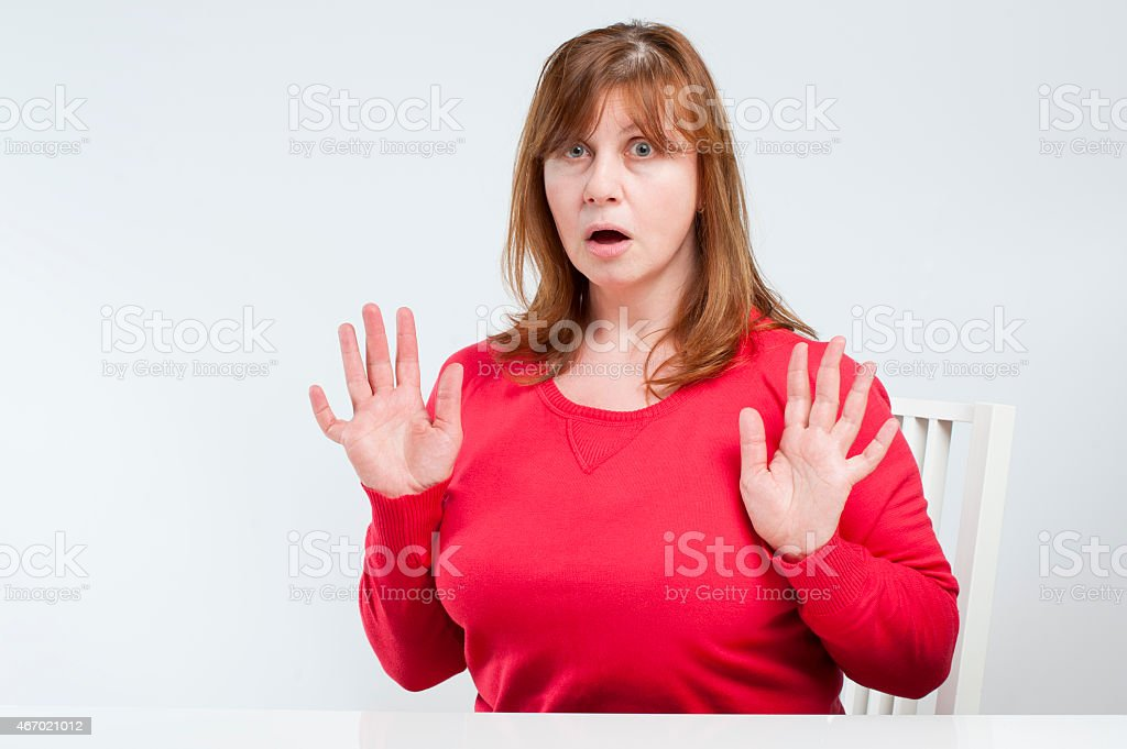 Frightened middle-aged woman. stock photo