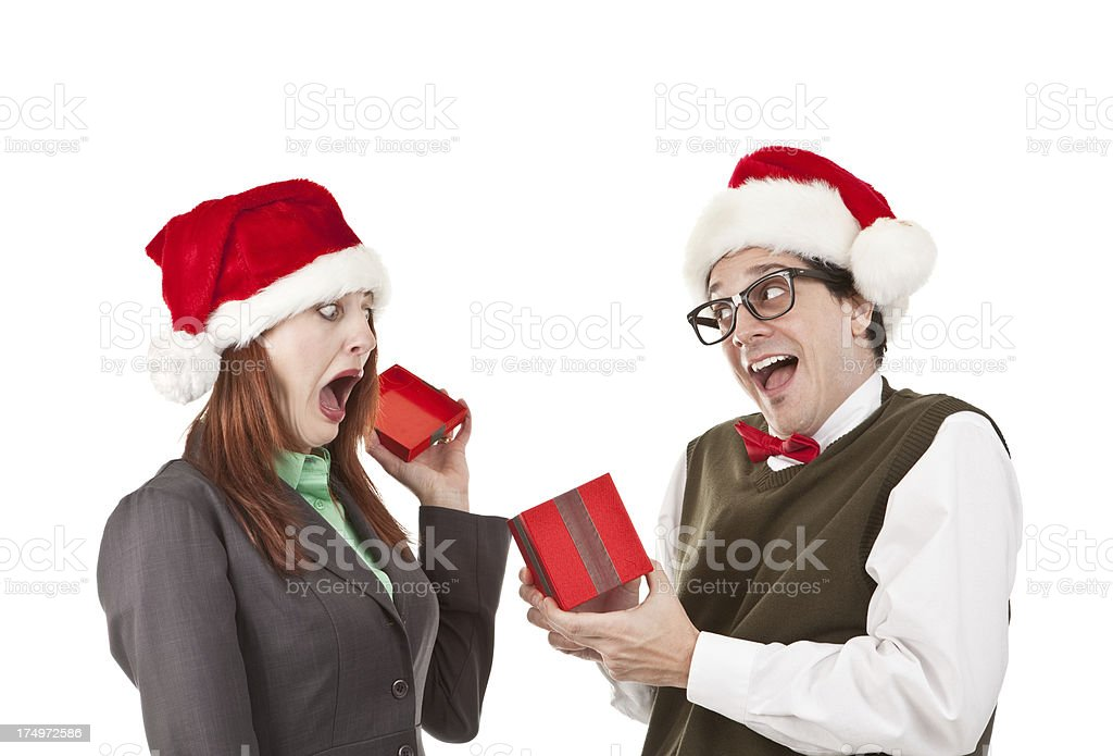 Frightened Woman Opeing Christmas Gift From Office Nerd royalty-free stock photo