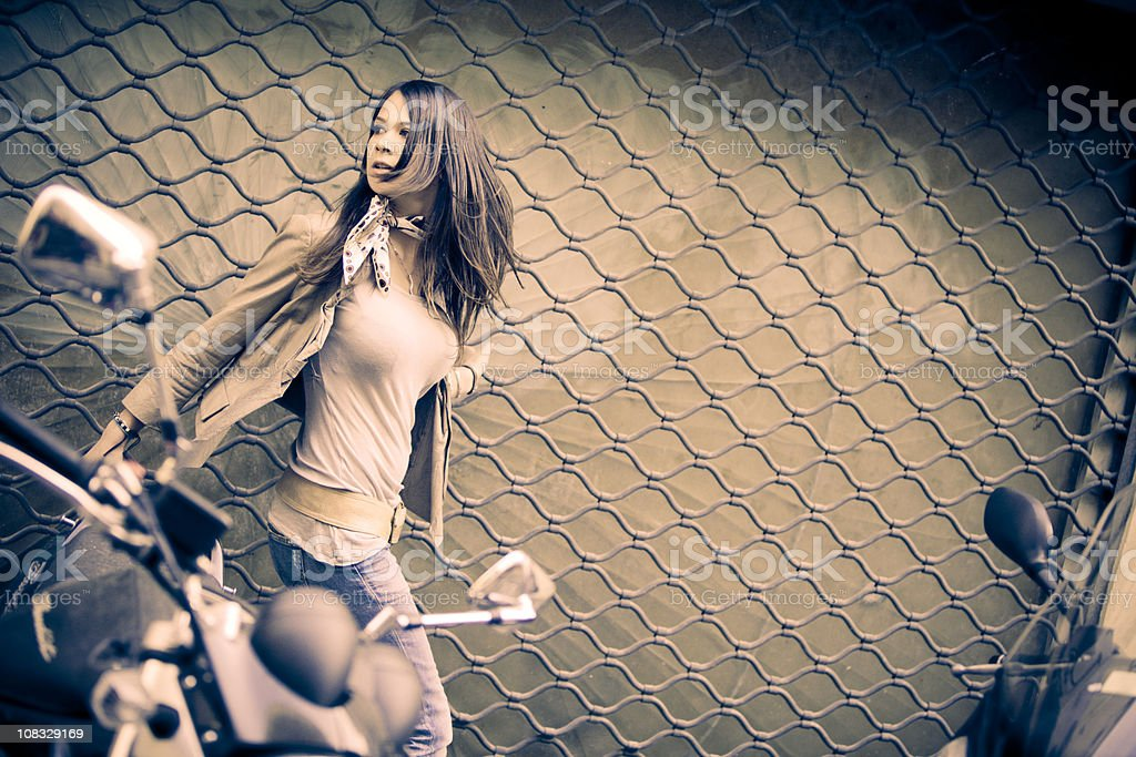 Frightened woman running down a dark street royalty-free stock photo
