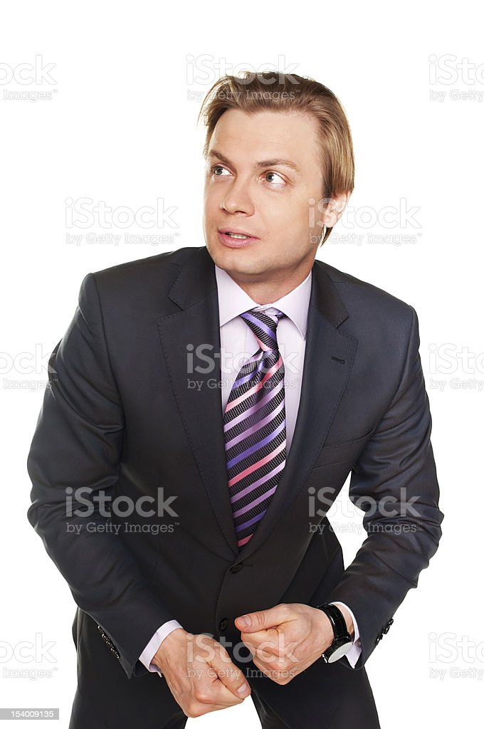 Frightened young businessman isolated on white wearing in formal suit stock photo