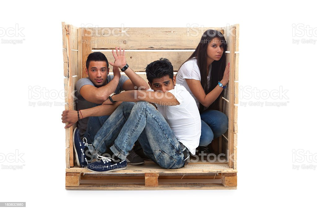 frightened young people in a box stock photo