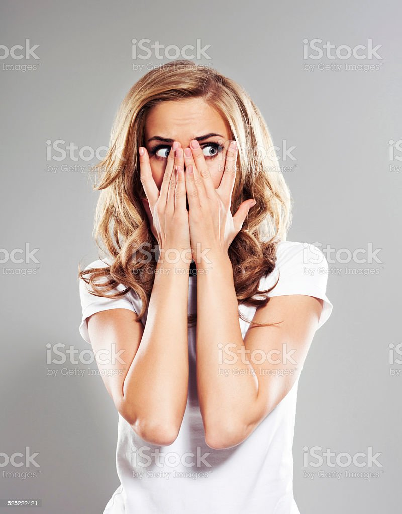 Frightened young woman, Studio Portrait stock photo